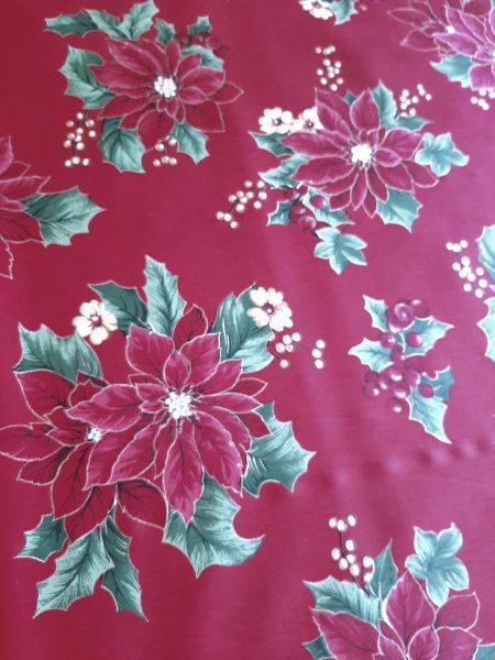 χριστουγεννιάτικο ύφασμα βαμβακοσατέν με αλεξανδρινό λουλούδι και πράσινα φύλλα σε κόκκινο φόντο και 2.80 φάρδος γιά εξαιρετικό τραπεζομάντηλο, ράνερ και την χριστουγεννιάτικη διακόσμηση