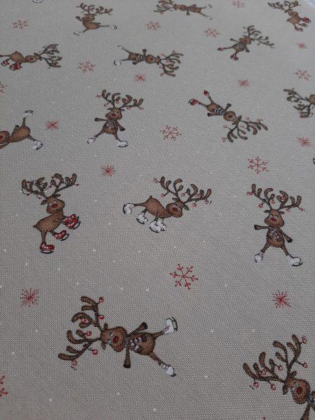 ύφασμα χριστουγεννιάτικο τύπου λινό σε μπέζ φόντο με μικρά ταρανδάκια κόμικ σε 2.80 φάρδος